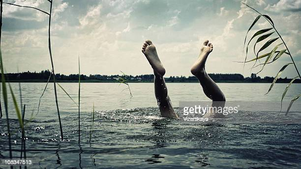 feet in water - taking the plunge stock photos and pictures