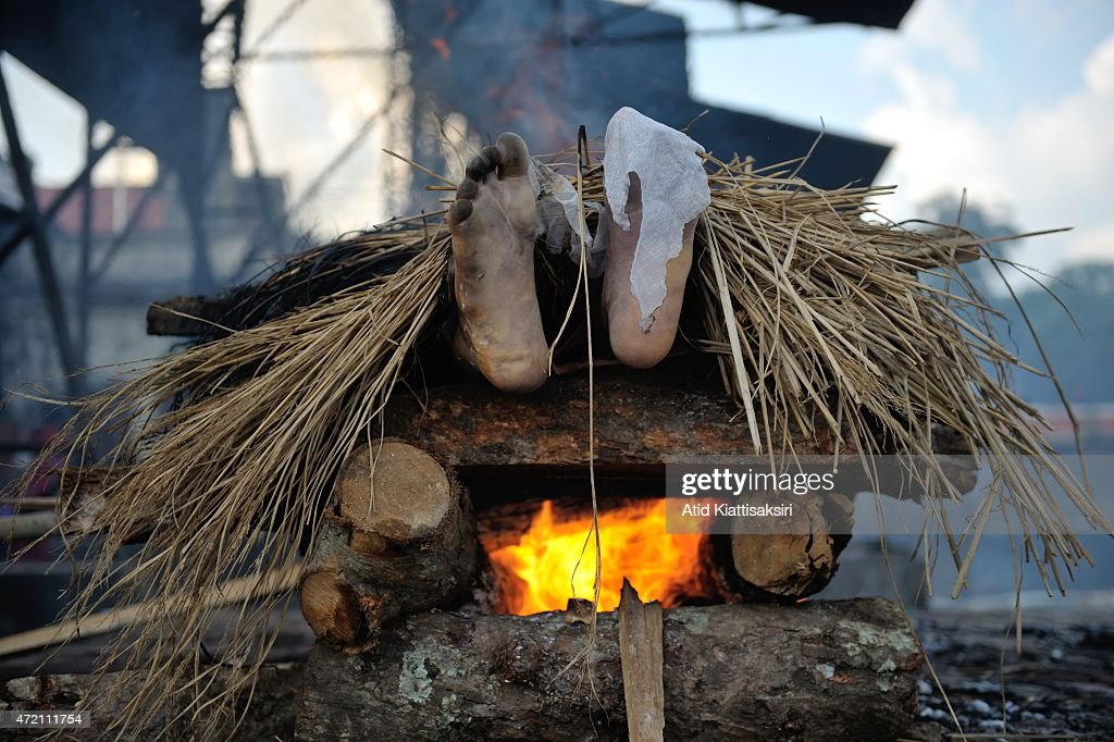 Feet of a body during a cremation in Pashupati. News Photo ...