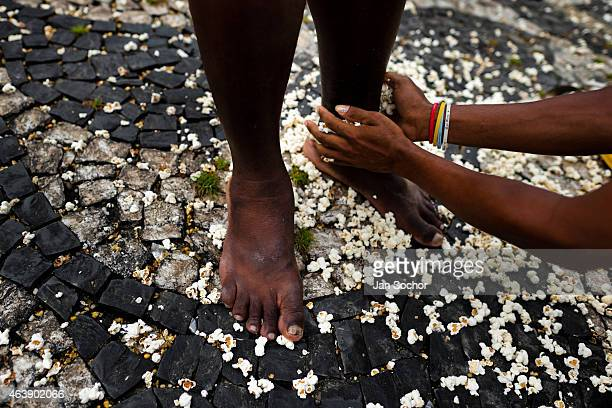 Feet of a Candomblé devotee seen during the popcorn bath an AfroBrazilian spiritual cleansing ritual performed in front of the St Lazarus church on...