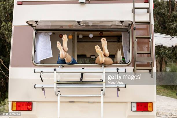feet of a couple on a window - stock photo - travelstock44 stock pictures, royalty-free photos & images