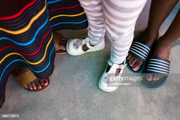 feet of a family together - human leg stock photos and pictures