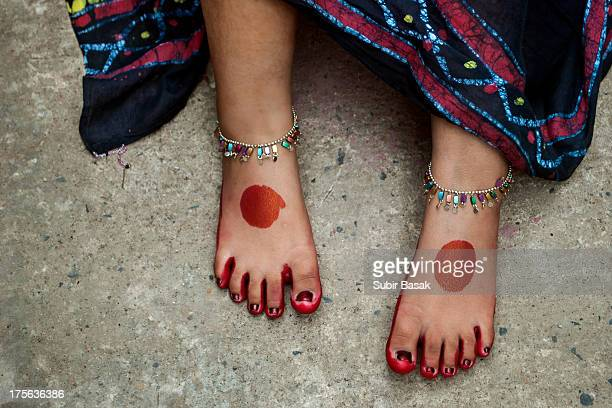 Feet of a girl with red dye and anklets