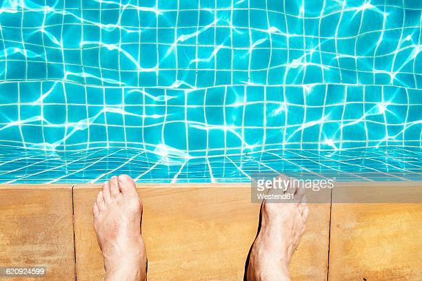 Feet of a man at pool edge