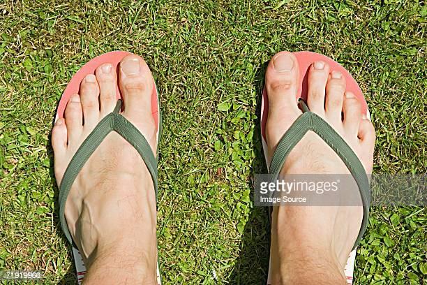 Feet of a man in flip flops