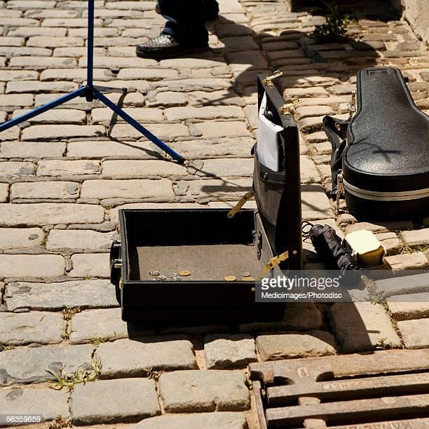 Feet of a street violinist on an old brick road, Prague, Czech Republic