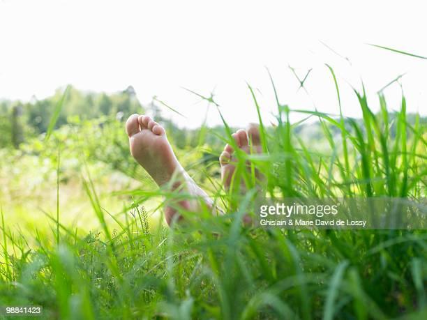 Feet of a woman in a field