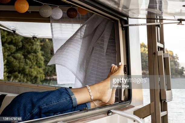 feet of a woman on a window - stock photo - travelstock44 stock pictures, royalty-free photos & images