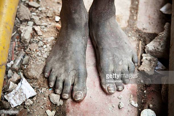 feet of a young indian man - dirty feet stock pictures, royalty-free photos & images