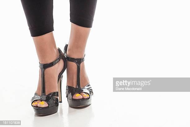 feet of a young woman wearing platform high heels - peep toe schuh stock-fotos und bilder