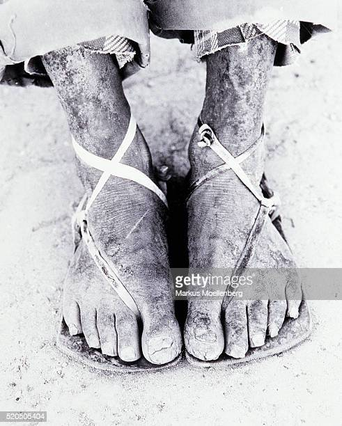 Feet of an old man in sandals