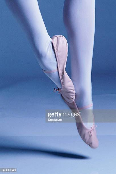 feet of ballerina in midair pose - nylon feet stock photos and pictures