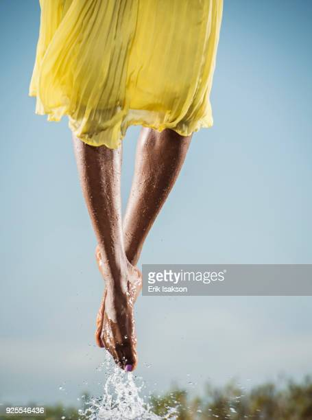 feet of black dancing jumping in water - black skirt stock pictures, royalty-free photos & images