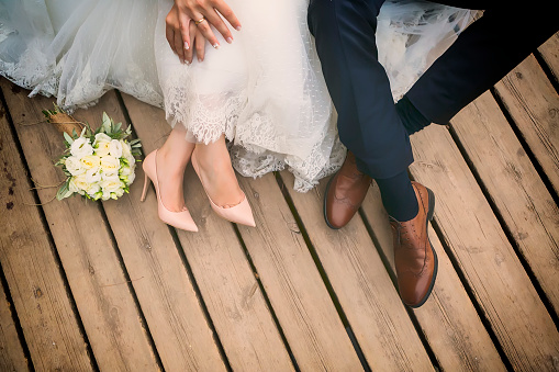 feet of bride and groom, wedding shoes (soft focus). 504615172