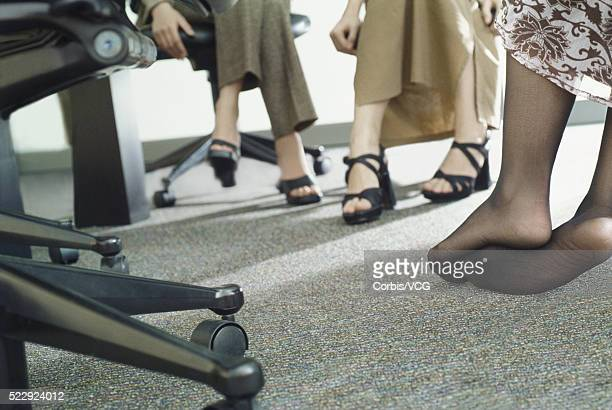 feet of businesswomen - stocking feet stock photos and pictures