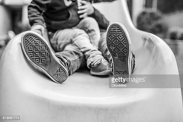 Feet of children in the playground