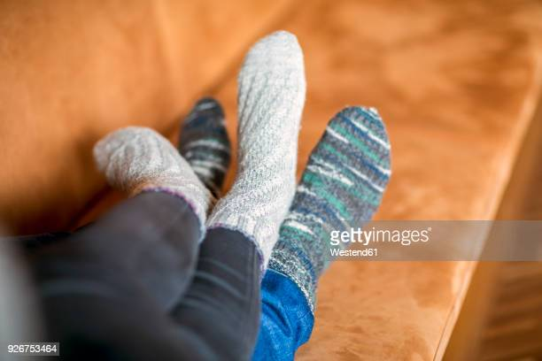 Feet of couple in love lying on couch