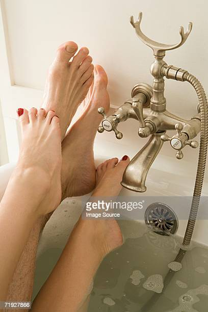 feet of couple in the bath - couple bathtub stock pictures, royalty-free photos & images
