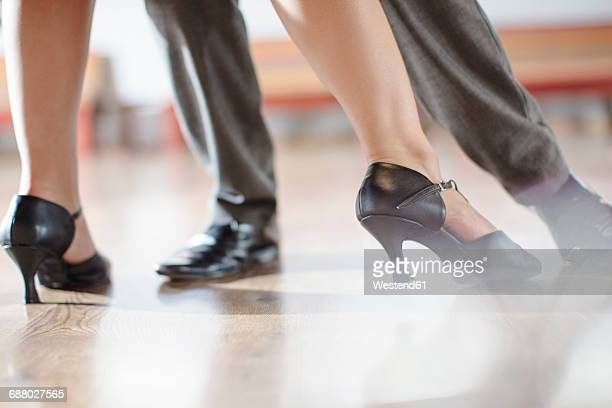 feet of dancing couple in studio - ballroom dancing stock pictures, royalty-free photos & images