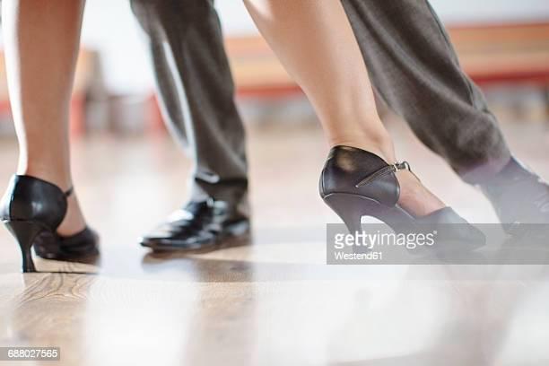 Feet of dancing couple in studio
