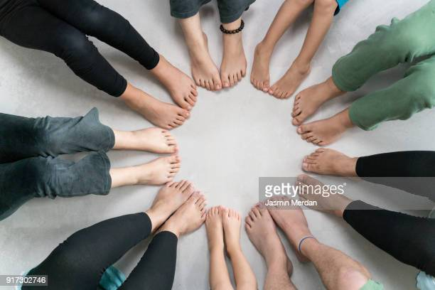 Feet of people in circle together