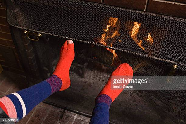 Feet of person by fire