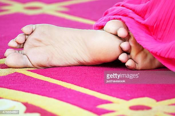 Feet of praying Thai woman