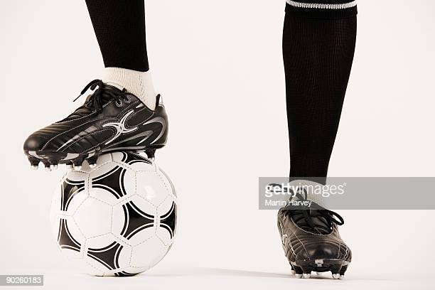 Feet of soccer player with ball