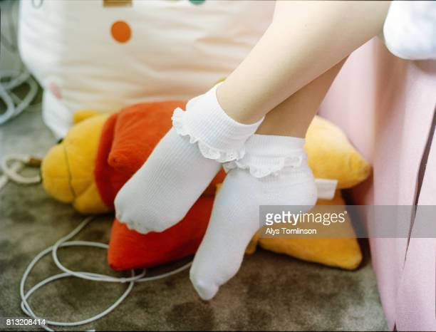feet of teenage girl in frilly socks - girls in socks stock photos and pictures