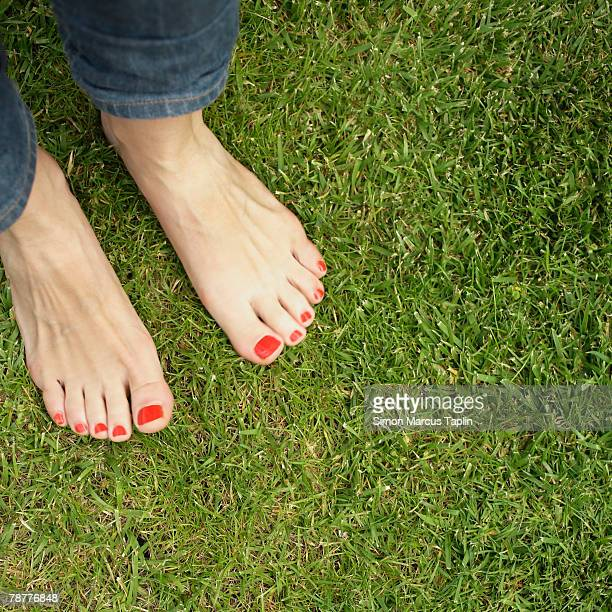 Feet of Teenage Girl with Painted Nails