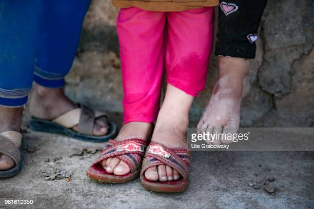 Feet of three little girls in the refugee camp Kabarto 2 in the District Semeel on April 23 2018 in DOHUK IRAQ