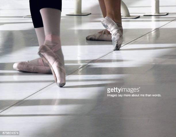 feet of two ballerinas rehearsing. detail. close up. - barre stock photos and pictures