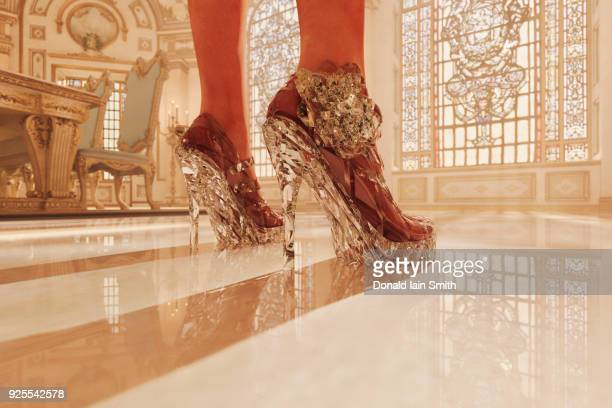 feet of woman wearing clear high heel shoes - fascino foto e immagini stock