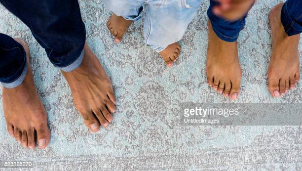 Feet of young family