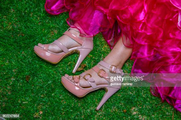 feet of young woman with pink shoes