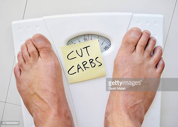 Feet on a scale with 'cut carbs' note