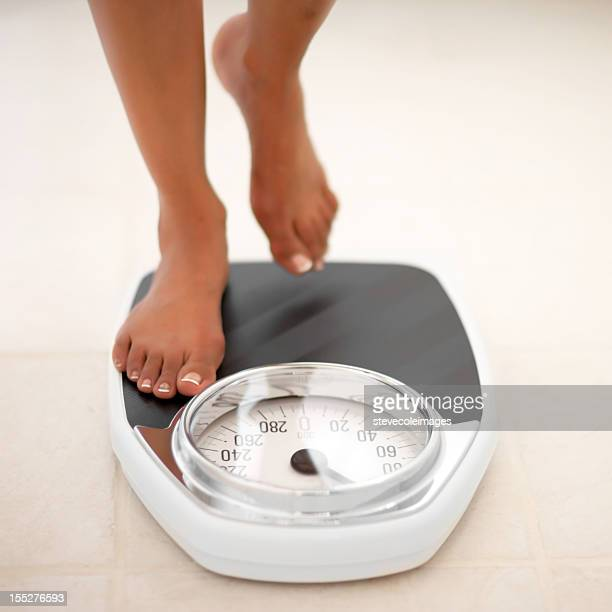 feet on bath scale - fat women in bath stock pictures, royalty-free photos & images