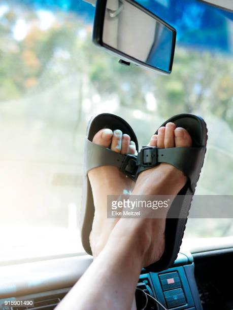 feet on dash board of a motor home or van - mallacoota stock pictures, royalty-free photos & images