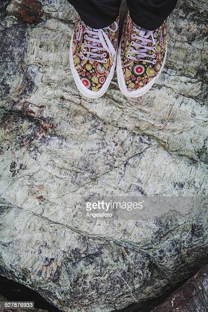 Feet on Green Striated Stone