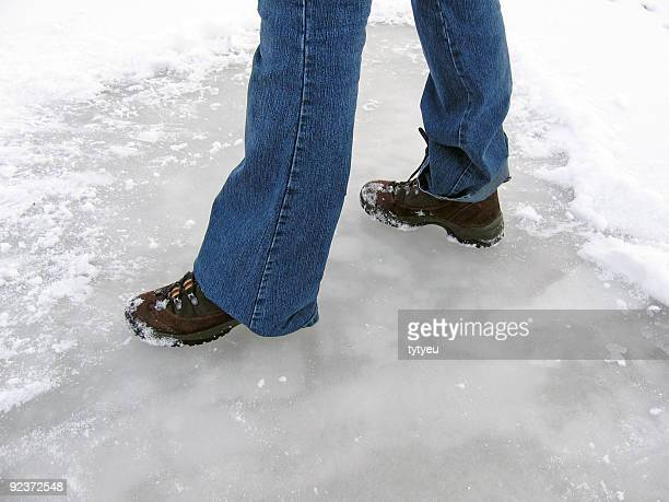 feet on ice - snow boot stock photos and pictures