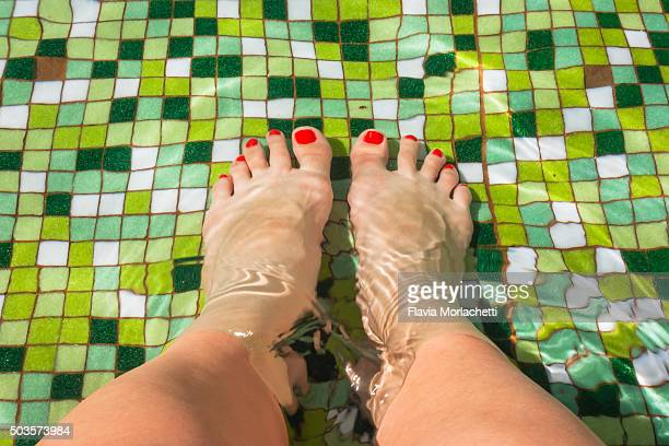 feet on swimming pool - santa fe province stock photos and pictures