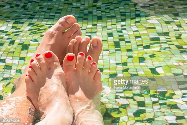 Feet on swimming pool