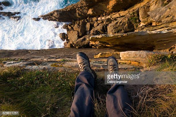 feet on the cliff