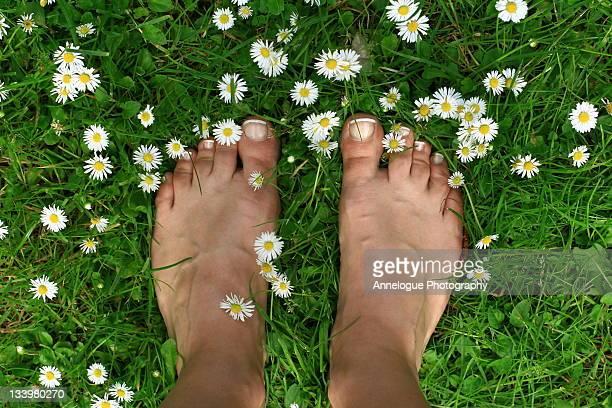 Feet standing on grass