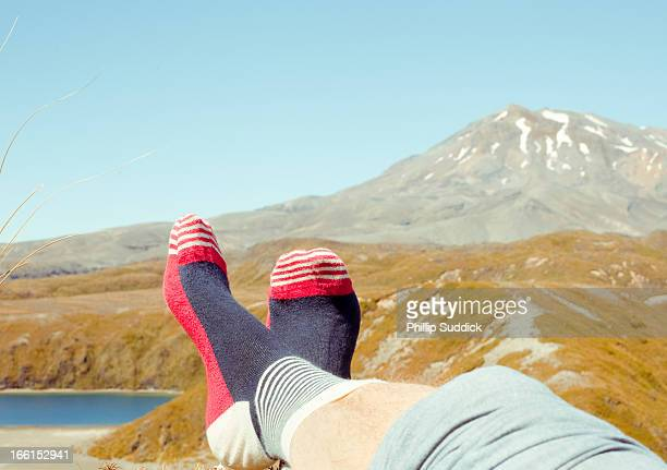 feet up in quirky socks relaxing in the mountains