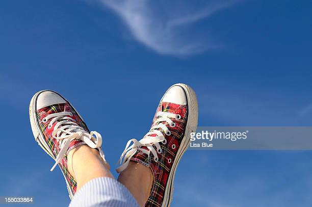 feet up w sport shoes against blue sky.copy space - feet up stock pictures, royalty-free photos & images