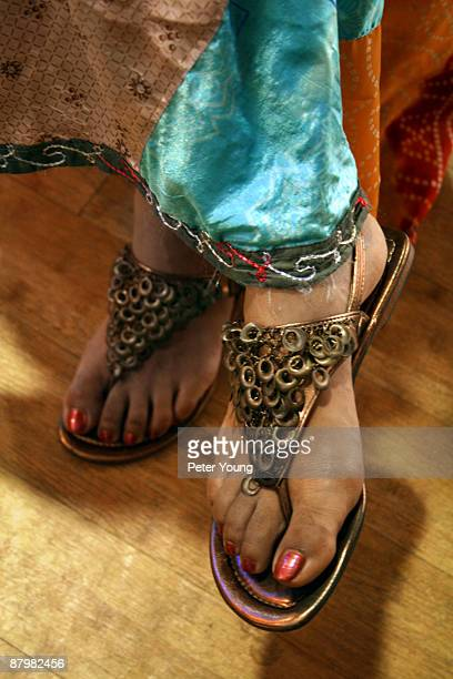 Feet with ethnic sandals and skirt