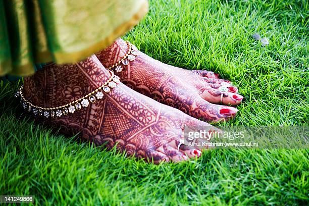 Feet with mehndi on grass