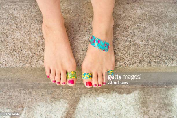 feet with patch - human foot stock pictures, royalty-free photos & images