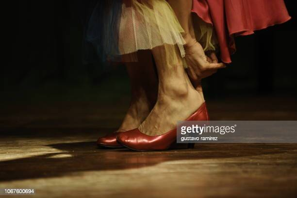 feet with red flamenco dancer shoes