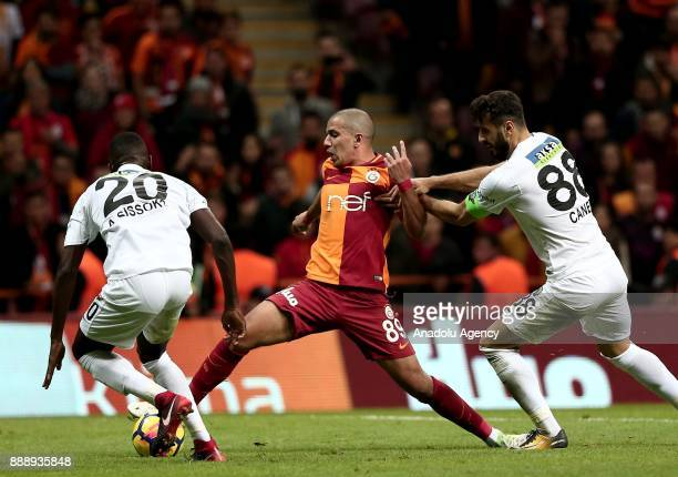 Feghouli of Galatasaray in action against Abdoul Sissoko of Teleset Mobilya Akhisarspor during the Turkish Super Lig match between Galatasaray and...